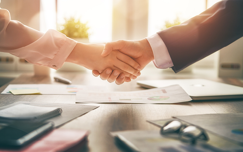 Two people shaking hands in an agreement