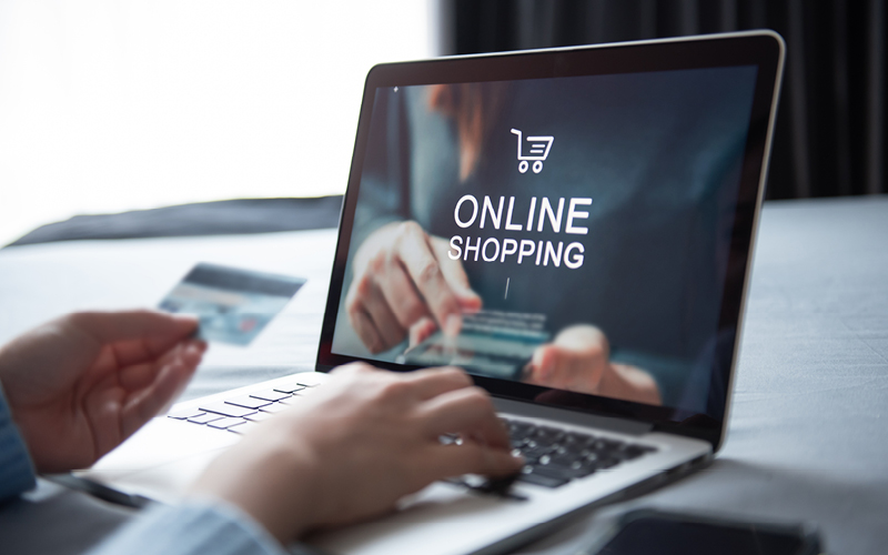 Someone shopping online on a laptop