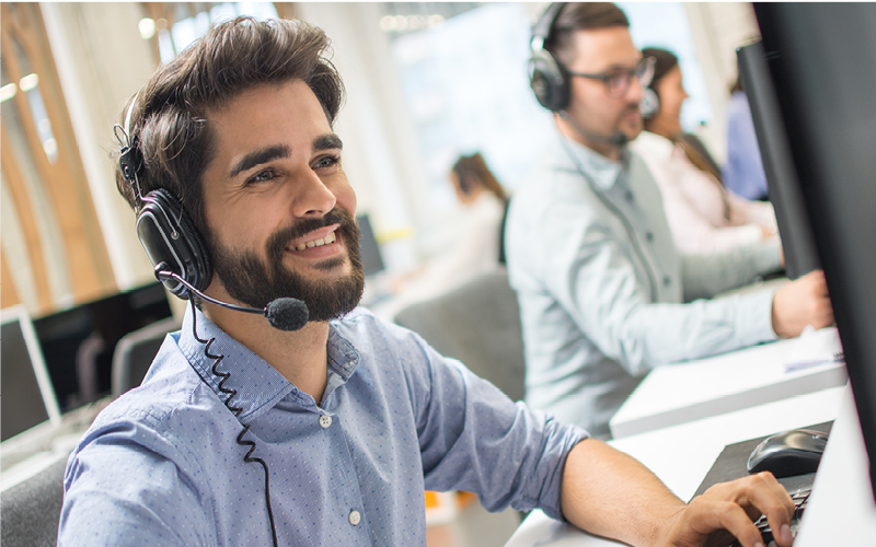 Happy man working in tech support